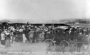 a photo of a crowd around a plane